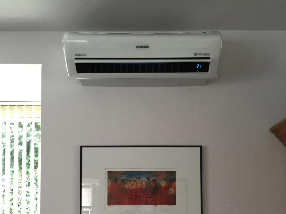 Woonkamer voorzien van samsung ar u aircoplanet airconditioning